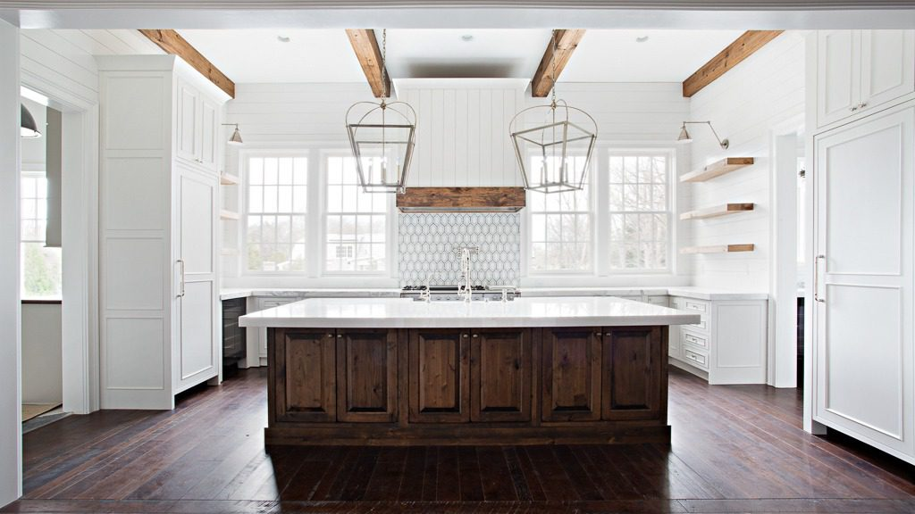 Kitchen in a Georgian-style home featuring reclaimed antique oak hardwood floors