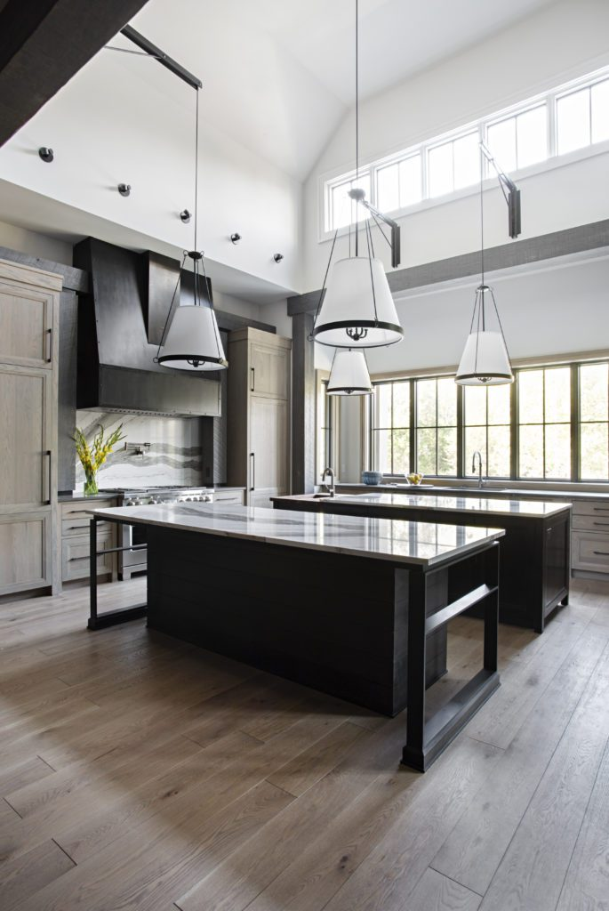 Black and white kitchen featuring wide plank hardwood flooring by Textures Nashville.