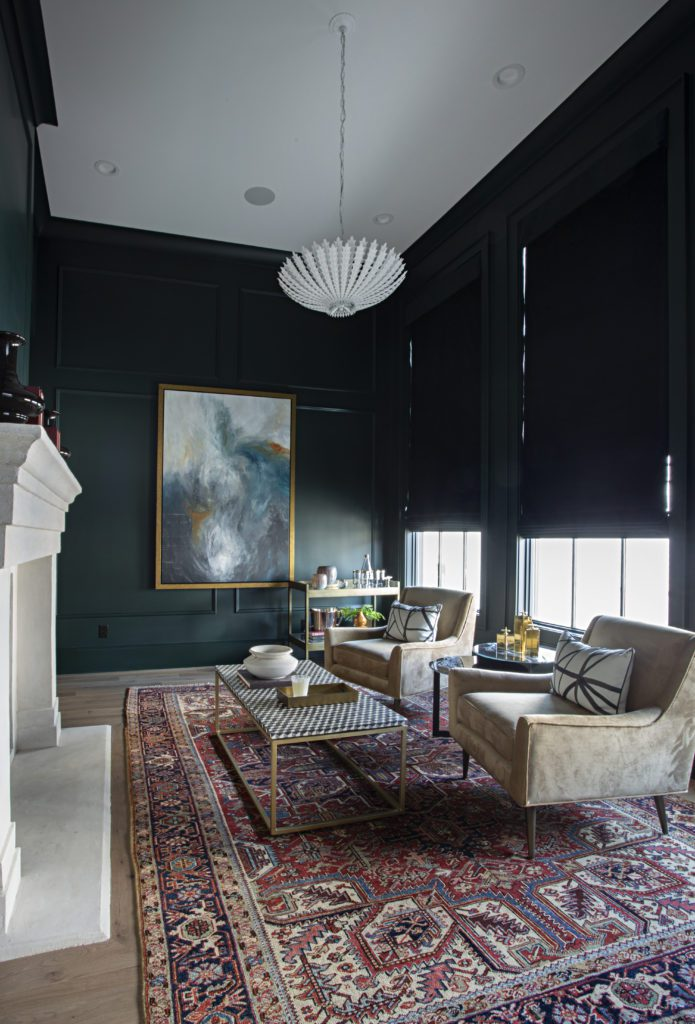 Luxe living area with fireplace and dark green walls featuring wide plank matte finish hardwood flooring by Textures Nashville.