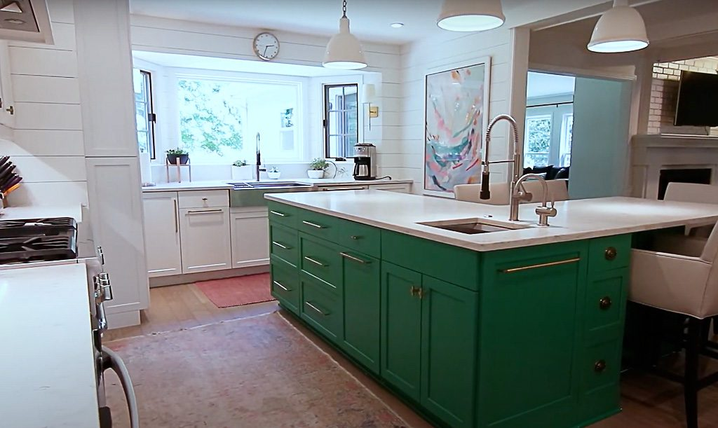Shiplap walls, green kitchen cabinets in modern kitchen with neutral custom wide plank hardwood floors by Textures Nashville
